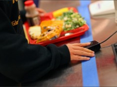 Students at Barboursville Middle School scan their index fingers as they go through the lunch line in Barboursville, W. Va. --Mark Webb/The Herald-Dispatch/AP