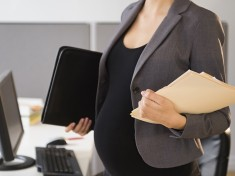 Pregnant woman in an office